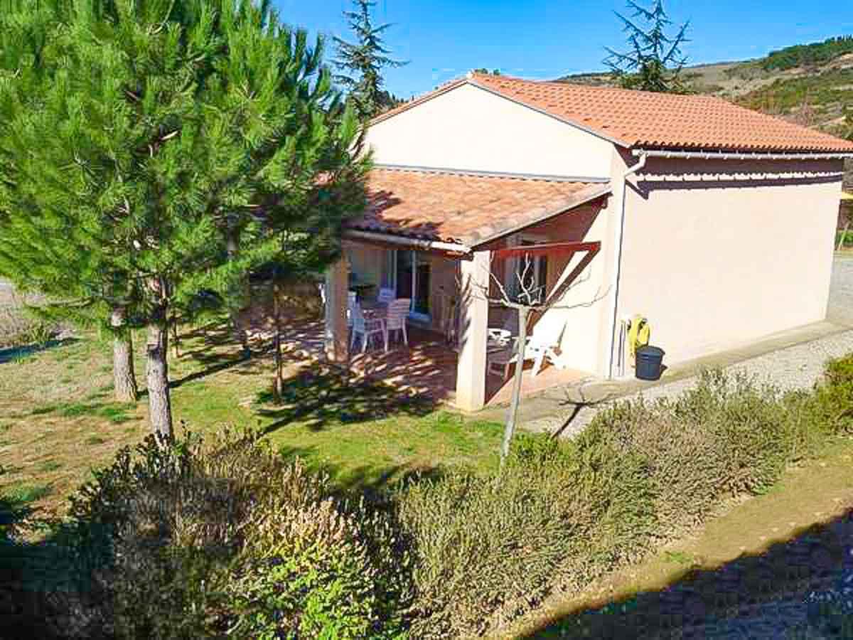 Maison terrasse couverte transats